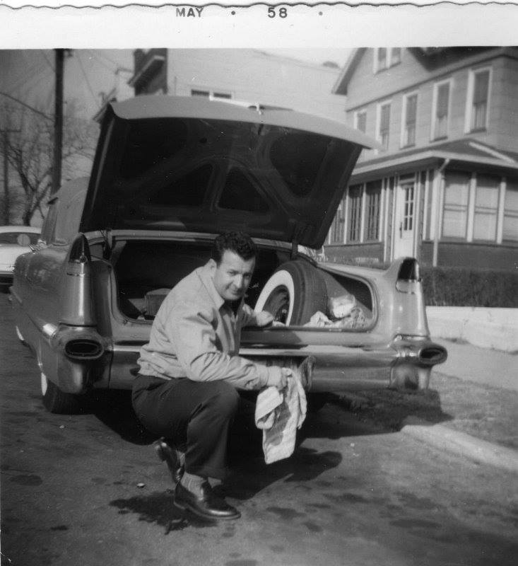 My dad polishing up his 1958 Caddy on Eggert Place in Far Rockaway.
