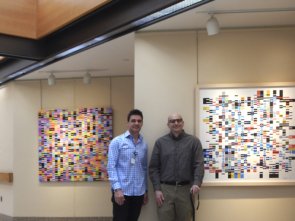 Tom Huck, Curator of Art at University Hospitals With Andrew Reach in Front of his work